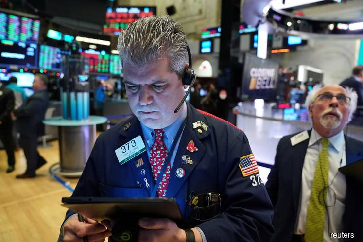 Wall Street slips from records as investors lock in year-end gains