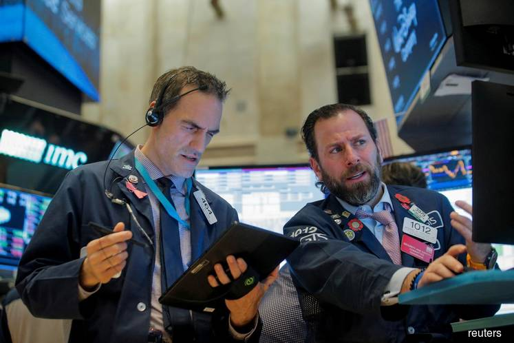 Wall St hits record highs on trade optimism, Apple gains