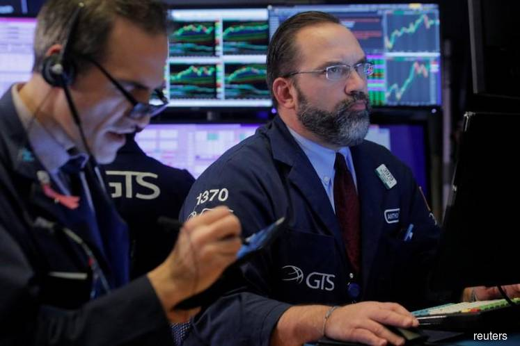 Wall Street dips from record in 'Jason Bourne market'