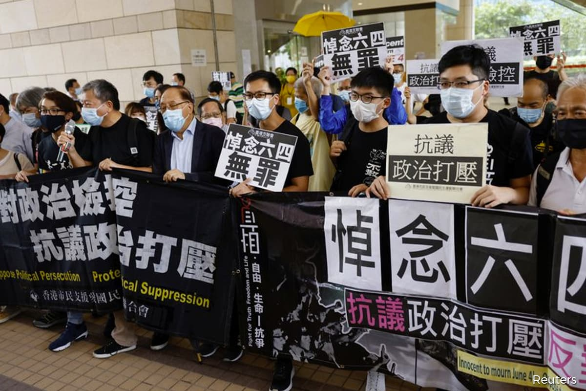 Two dozen Hong Kong activists appear in court over banned Tiananmen vigil