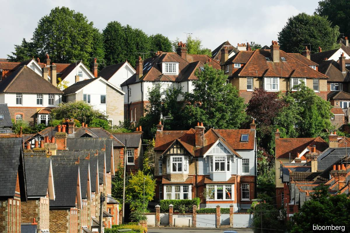 House prices end 2020 at record high but growth slows in December