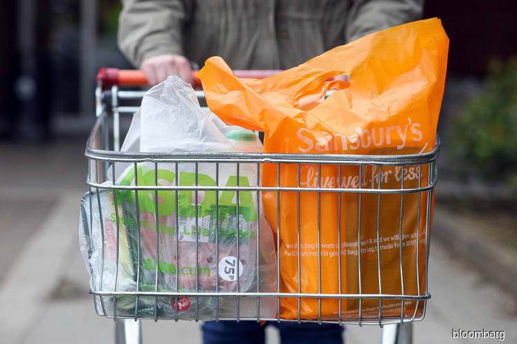 Walmart explores selling a stake in U.K. grocer Asda