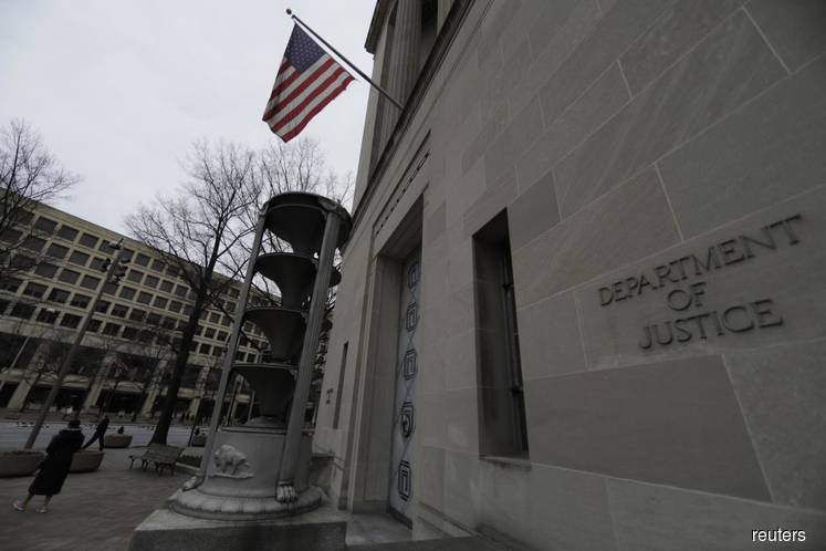 U.S. DOJ charges property firm founder, former execs in Ponzi scheme