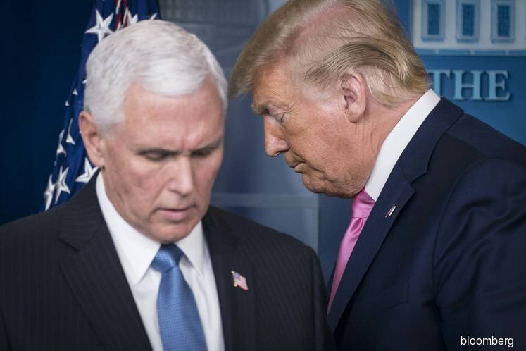 U.S. President Donald Trump (right) and U.S. Vice President Mike Pence (Photo by: Bloomberg)