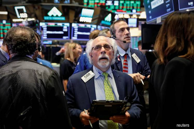 U.S. stocks slip from record as dollar advances