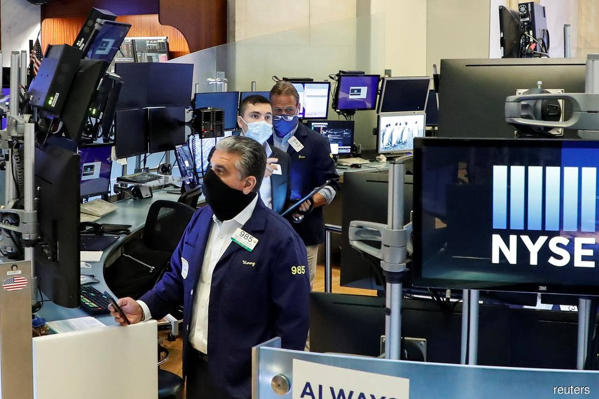 Dow hits record high on boost from economy-linked stocks; Nasdaq drops
