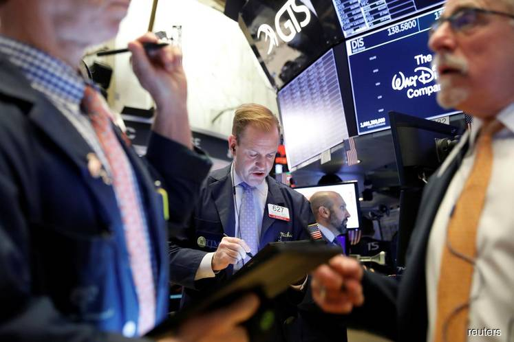 Wall St hits new record high on Disney, Best Buy