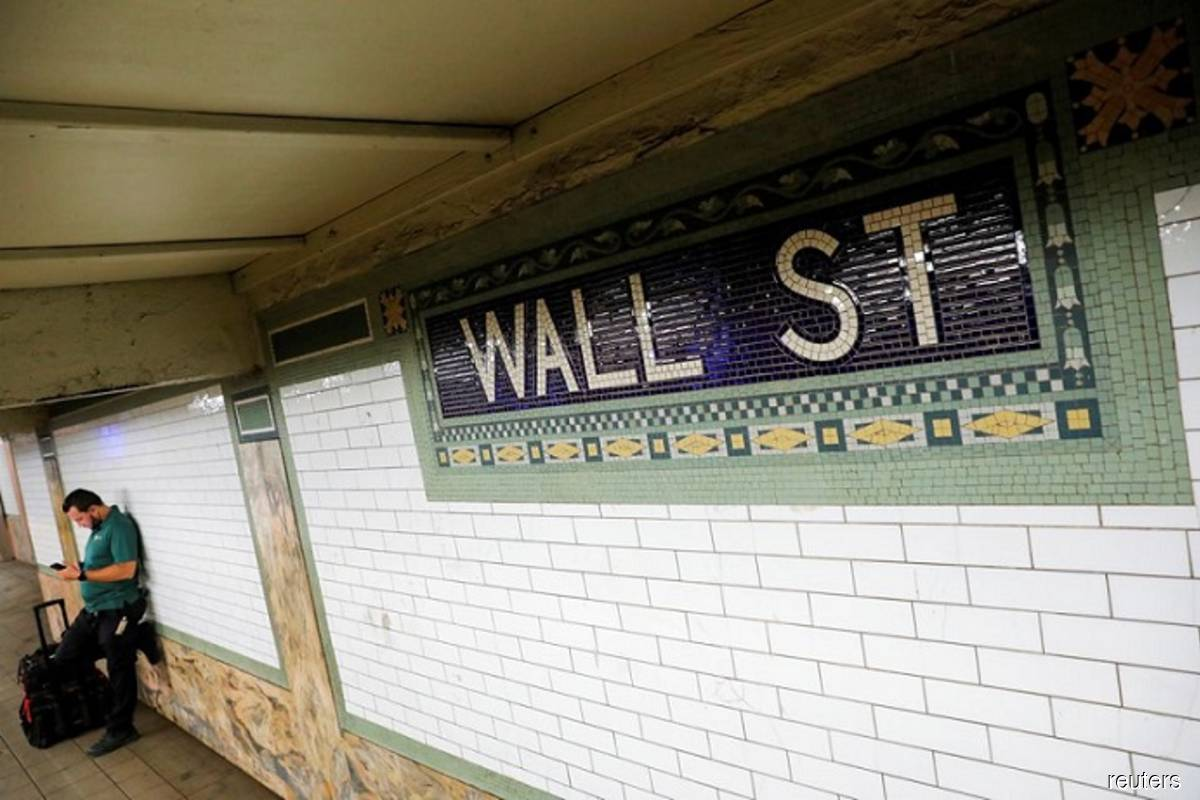 A person waits on the Wall Street subway platform in the Financial District of Manhattan, New York City, US on Aug 20, 2021. (Photo by Andrew Kelly/Reuters filepix)