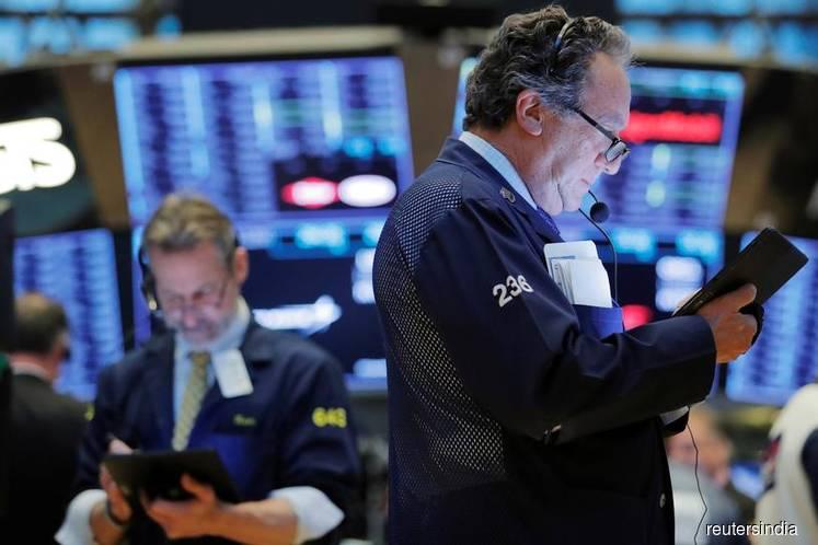 Upbeat data, trade hopes lift Wall Street