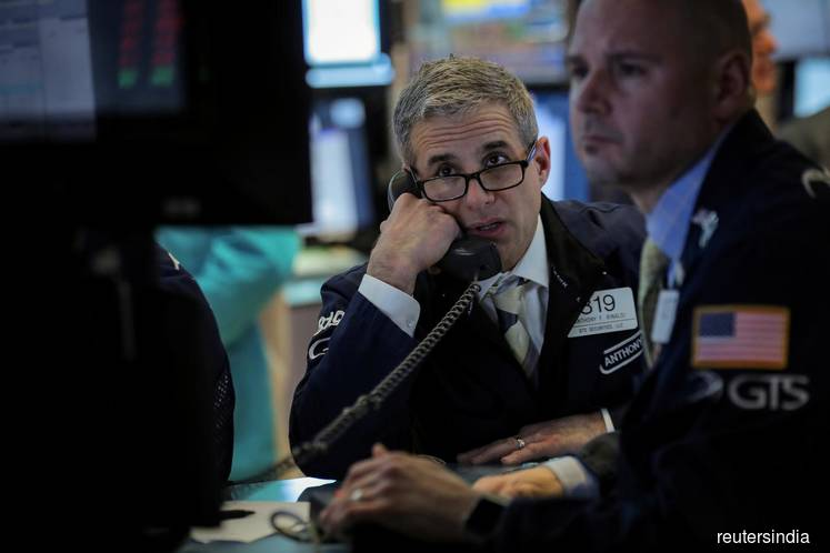 Stocks edge lower; oil rises to five-month high