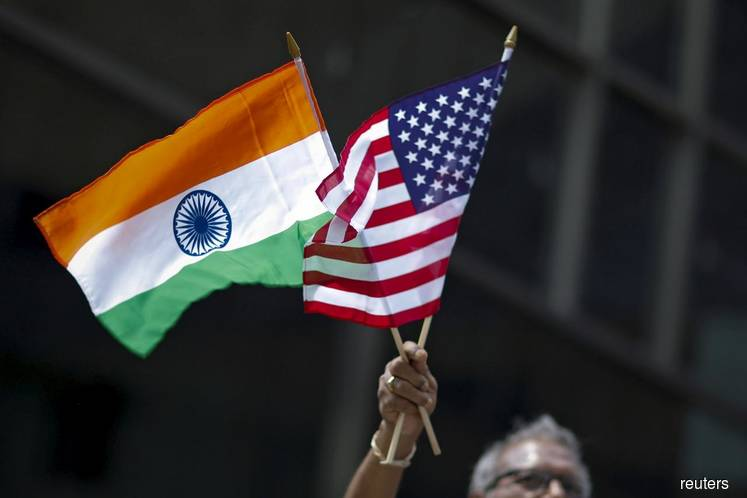 U.S. pushes India to buy US$5b-US$6b more farm goods to seal trade deal — sources