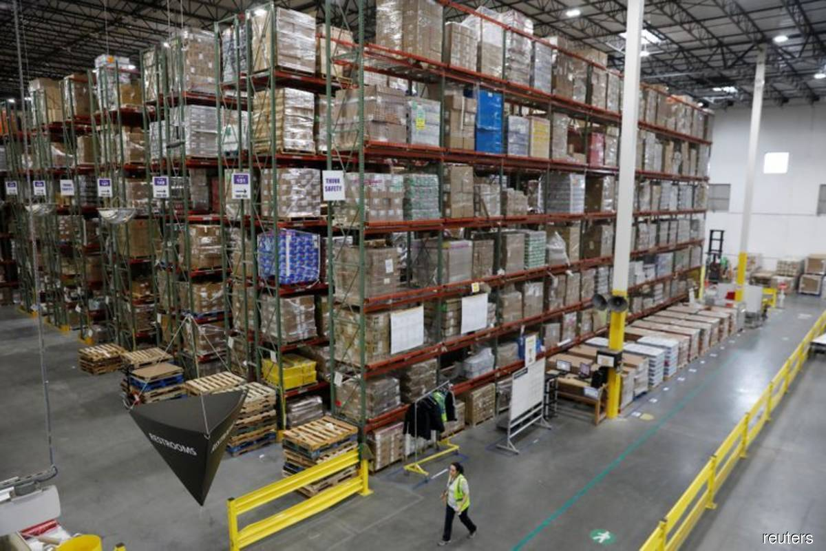 US business inventories increase solidly in October