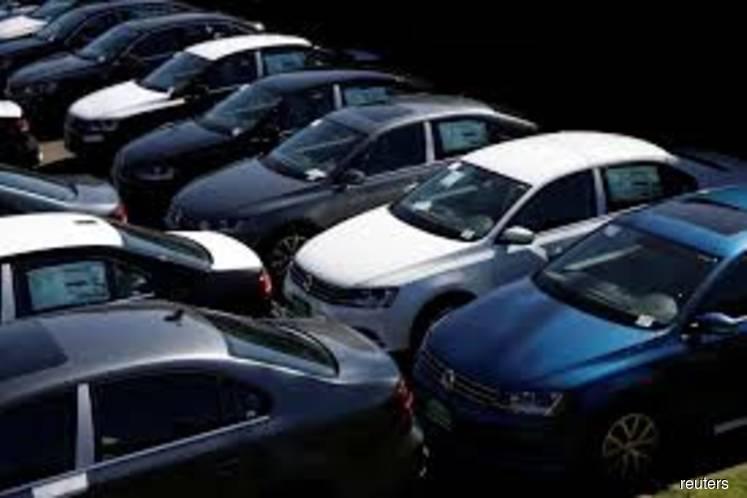 Moody's sharply cuts global auto sales outlook on coronavirus fallout