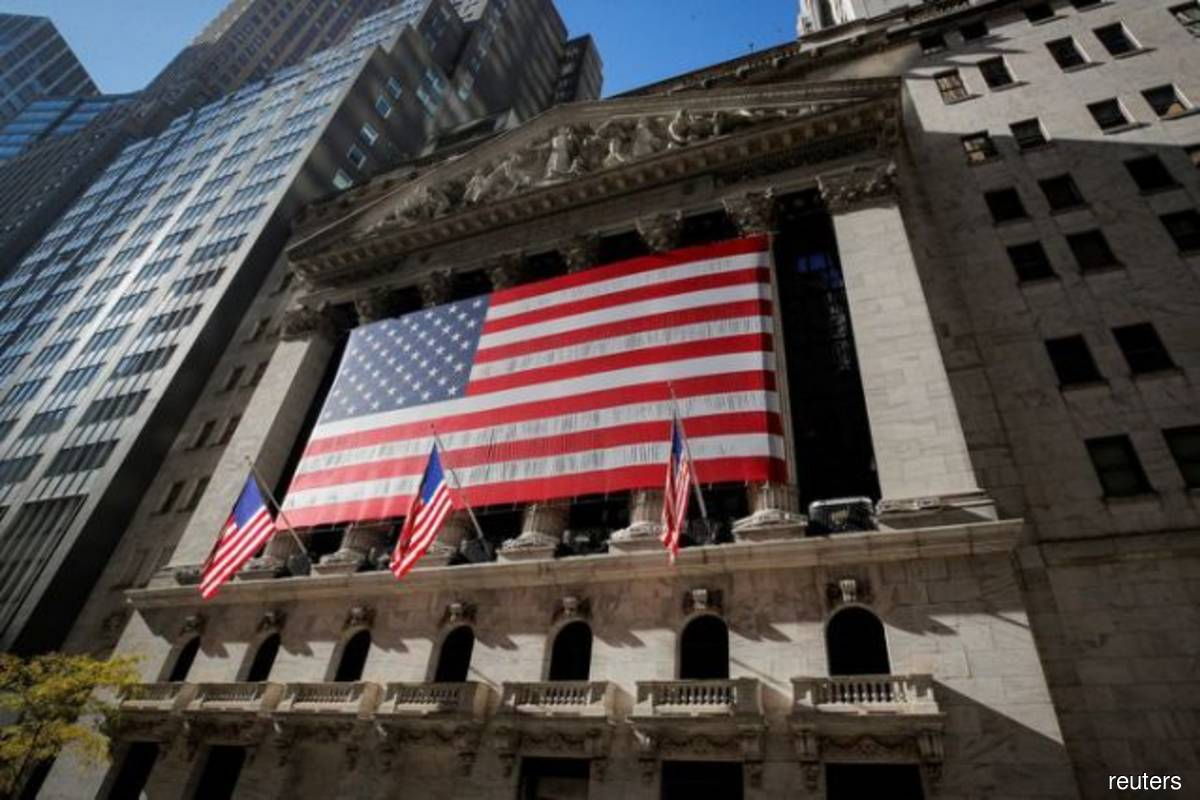 Nasdaq touches record high; Dow, S&P 500 lifted by J&J