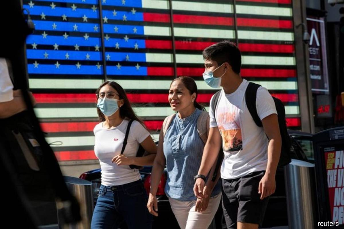 People wear masks around Times Square in New York City, US on July 23, 2021, as cases of the infectious coronavirus (Covid-19) Delta variant continue to rise. (Photo by Eduardo Munoz/Reuters)