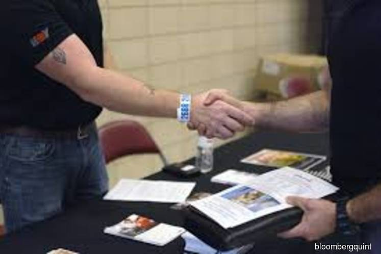 U.S. jobs top forecast at 263,000 gain; wages miss estimates
