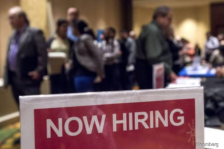 Job openings in U.S. fall to 18-month low as hiring holds up
