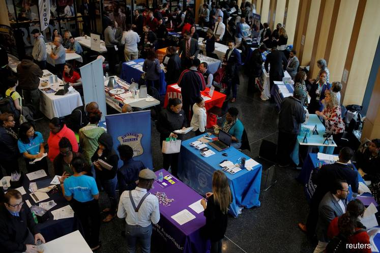 Strong US jobs growth expected in May, trade tensions a threat