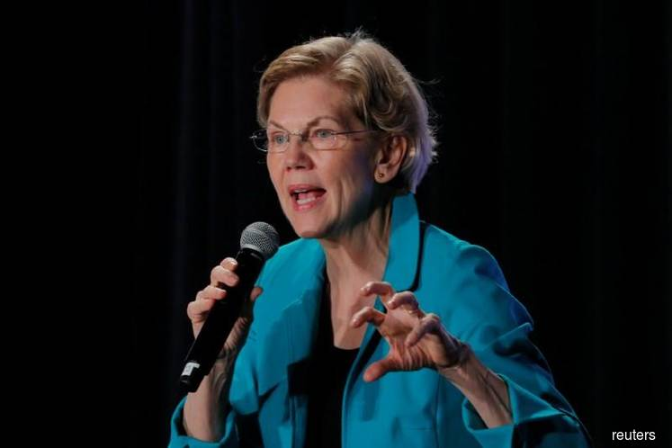 Warren calls on big U.S. banks for steps on climate risk