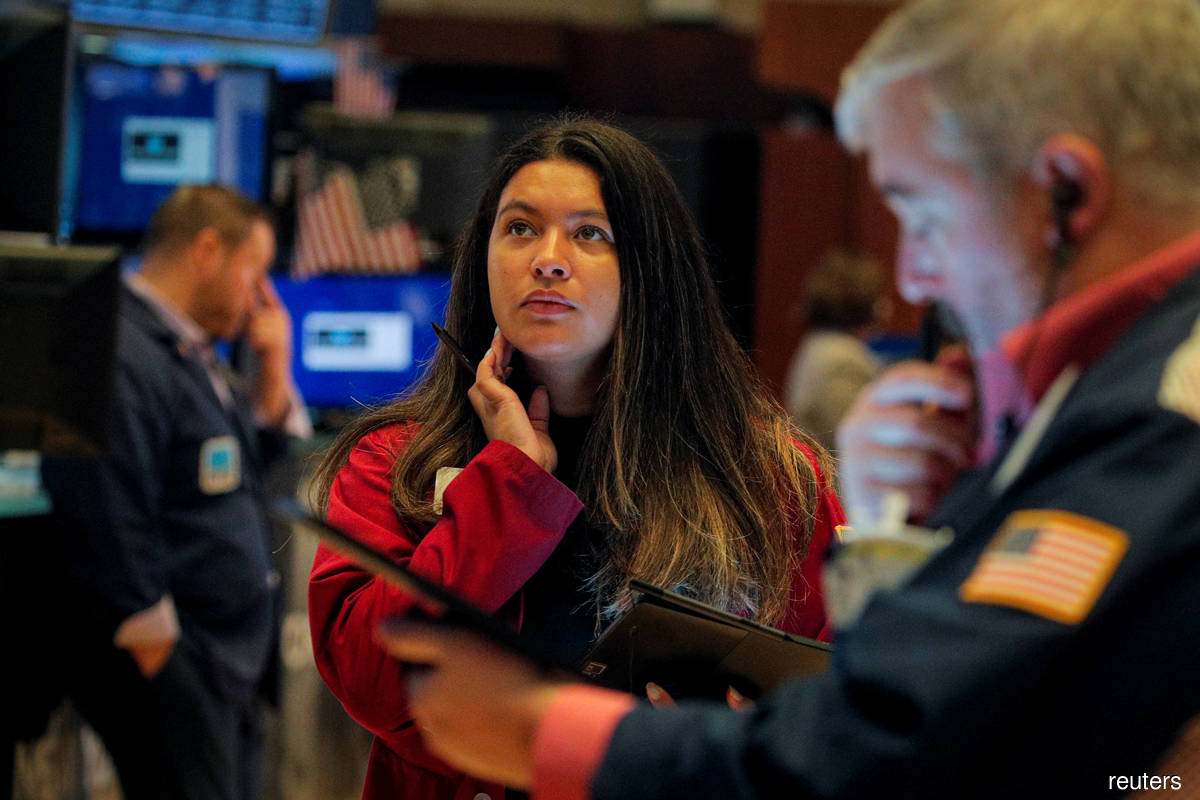 S&P 500 surges, biggest daily percentage rise since March on earnings, data