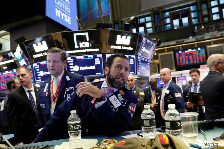 Wall Street hovers near record levels; Boeing drags on Dow