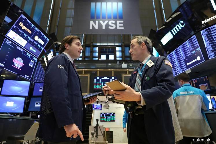 Wall St at record levels on trade hopes, robust economic data