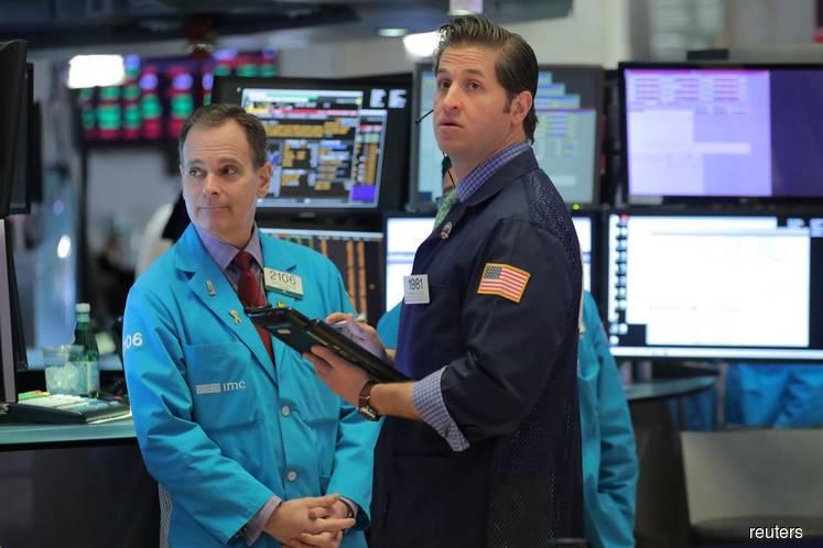 U.S. stocks rally past milestones on tech surge