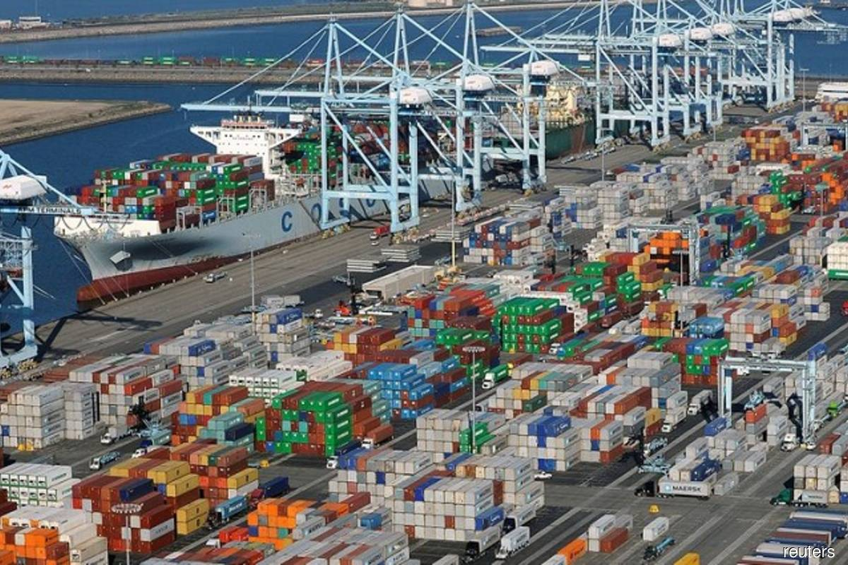 Shipping containers sit at the ports of Los Angeles and Long Beach, California, US in this aerial photo taken on Feb 6, 2015. (Photo by Bob Riha, Jr./Reuters filepix)