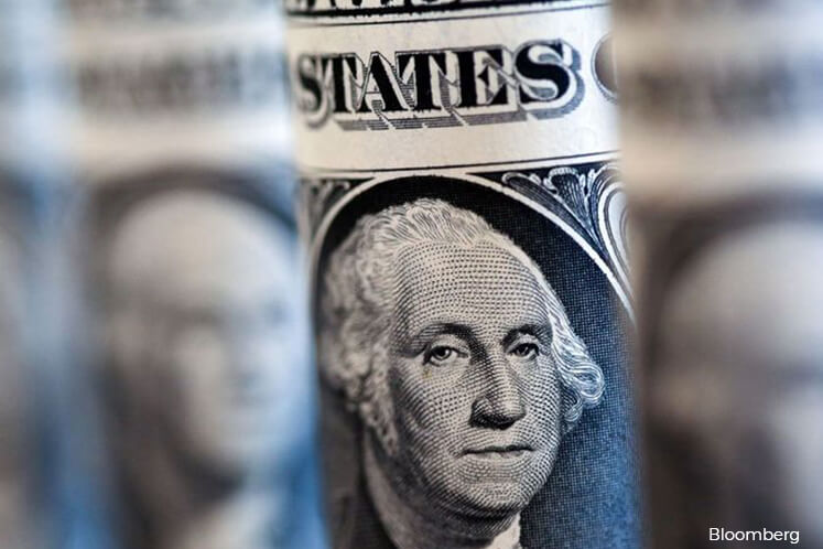 Dollar set for weekly gain before Fed meeting