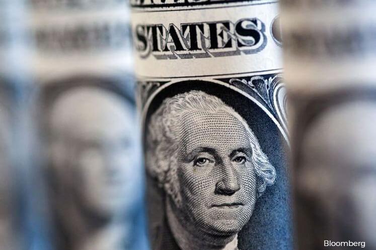 Dollar near 3-year peak amid mad cash scramble
