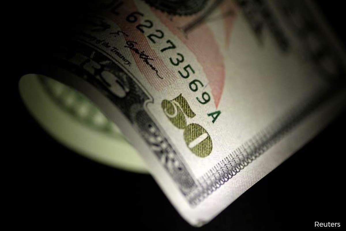 Dollar slips early against pound, kiwi looks to RBNZ