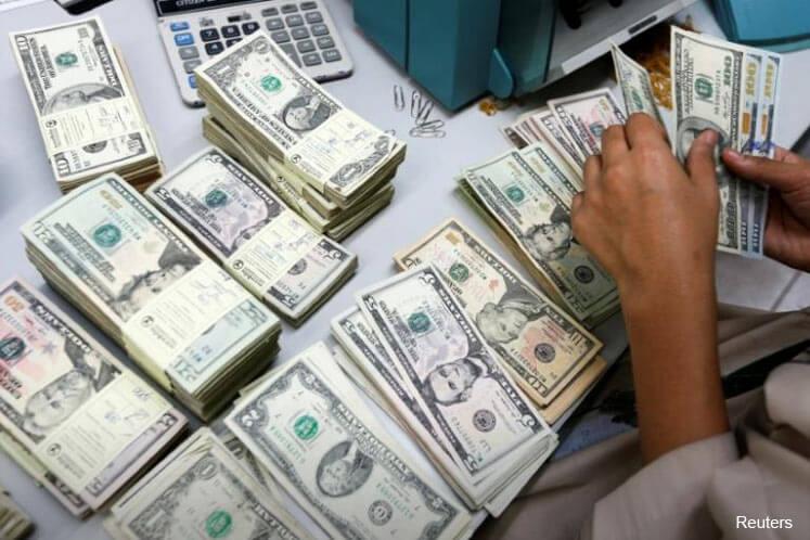 Fed speakers halt US dollar slide with talk of rate rises