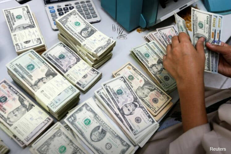 US dollar pulls higher on Fed talk, sterling slips on Brexit anxiety