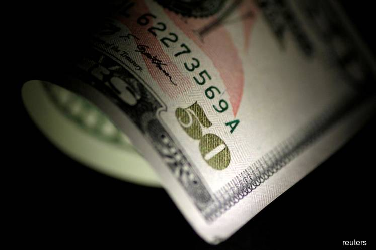 Dollar climbs down as panic subsides, on course for biggest loss in decade