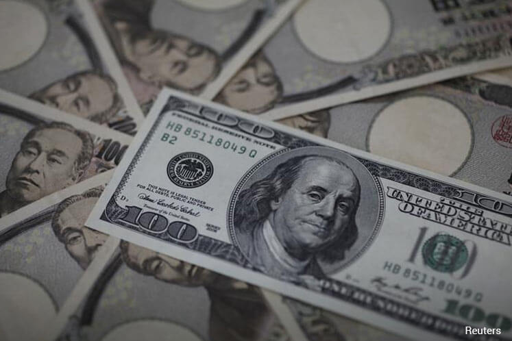 Dollar edges up vs yen on 'gotobi' payment date, faces summit pressure