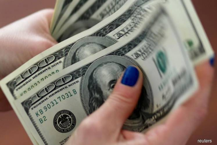 Dollar on defensive after Fed signals readiness to cut rates