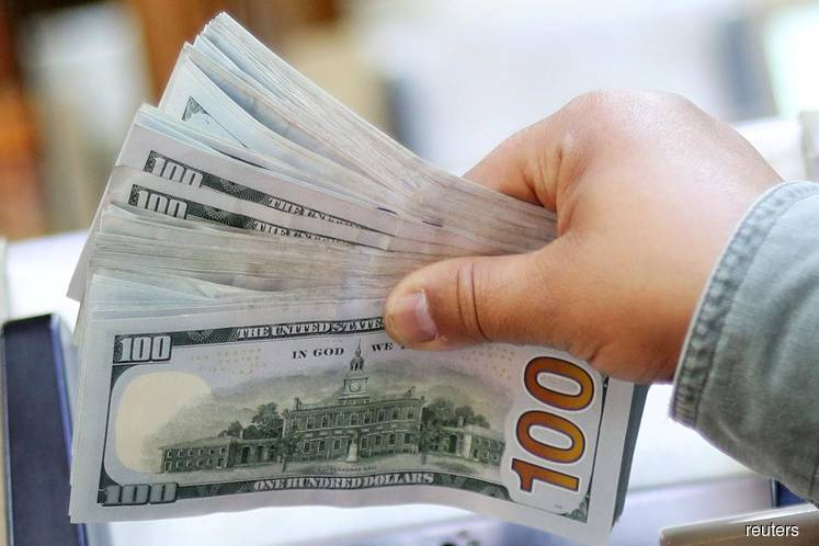 Dollar on course for weekly loss as Fed joins rate cut camp