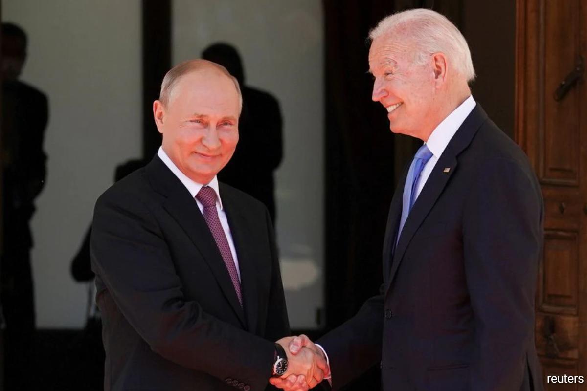 U.S. President Joe Biden and Russia's President Vladimir Putin shake hands as they arrive for the U.S.-Russia summit.