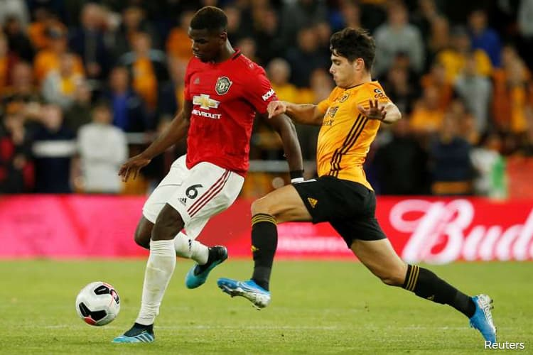 United held at Wolves after Neves screamer, Pogba penalty miss