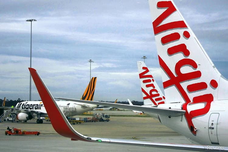 Virgin Australia stops all flights except essential services