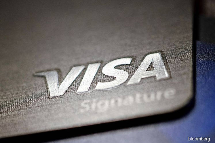 Visa says consumer spending has 'sharply declined,' even online