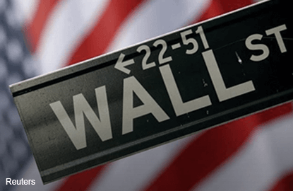 Wall St falls before earnings and on U.S. policy uncertainty