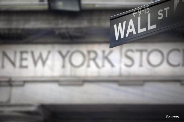 Wall Street edges lower, energy stocks fall