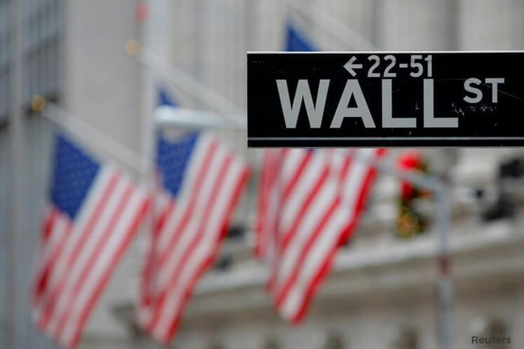 Wall St drops on weak jobs data, missile strikes on Syria