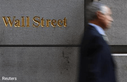 Wall Street sinks after Fed fails to impress