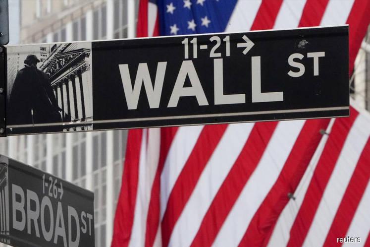 Investors brace for market swings as Trump slips in election polls