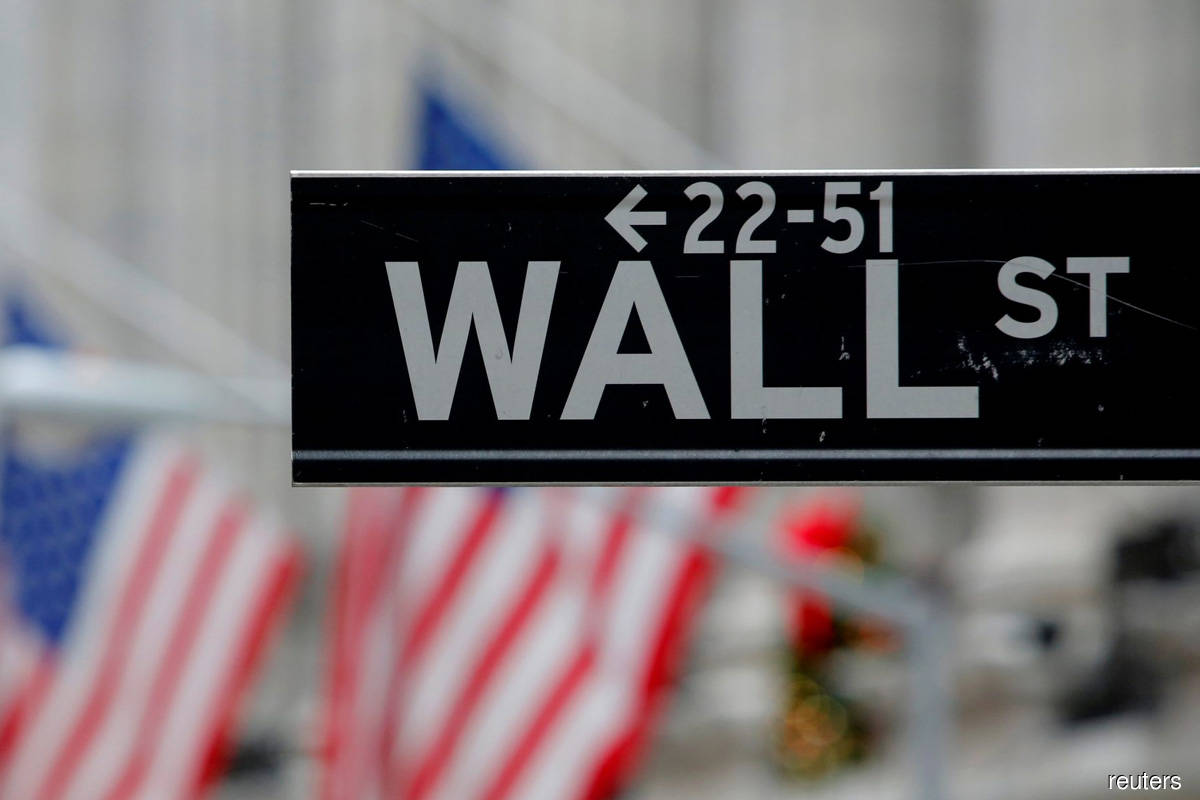 Wall Street ends lower as Apple and Tesla retreat