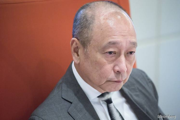 UOB billionaire's scion says 'why not' let outsider succeed him