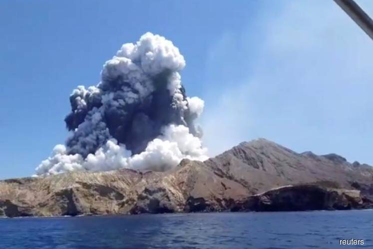 Spitting volcano keeps search parties off New Zealand island, death toll rises to six