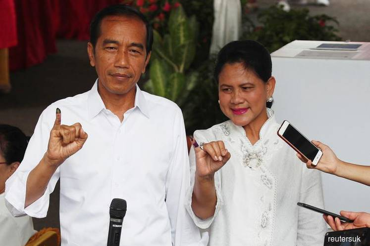 Indonesia's Widodo looks set for election victory — challenger says no